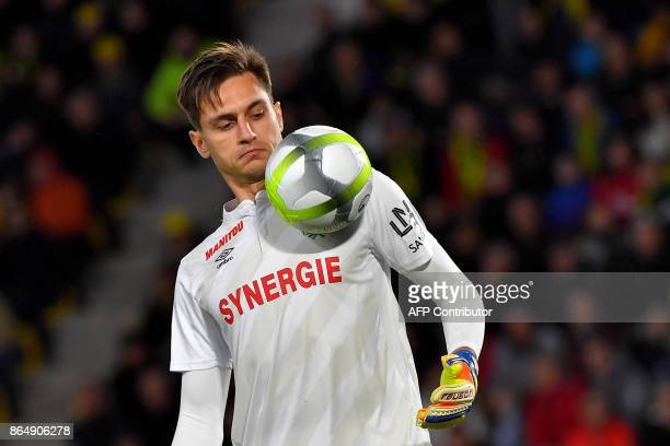 Nantes' French goalkeeper Ciprian Tatarusanu eyes the ball during the French L1 football match Nantes vs Guingamps at the La Beaujoire stadium in...