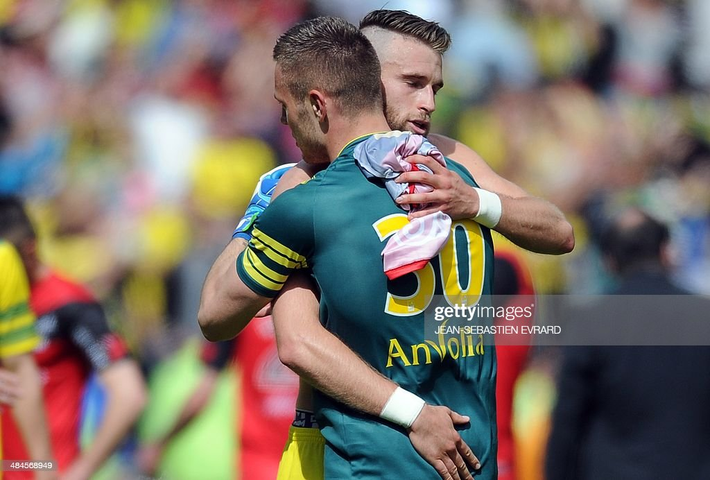Nantes' French goalkeeper Maxime Dupe (R) and Nantes' French midfielder Lucas Deaux celebrate after winning the French L1 football match between Nantes and Guingamp on April 13, 2014 at the Beaujoire stadium in Nantes, western France.
