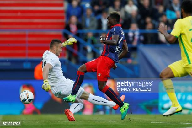 Nantes' French goalkeeper Maxime Dupe vies for the ball with Caen's French forward Yann Karamoh during the French L1 football match between Caen and...