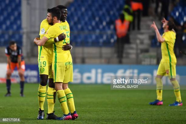 Nantes' French midfielder Abdoulaye Toure and Nantes' French defender Leo Dubois react after wining the French L1 football match MHSC Montpellier vs...