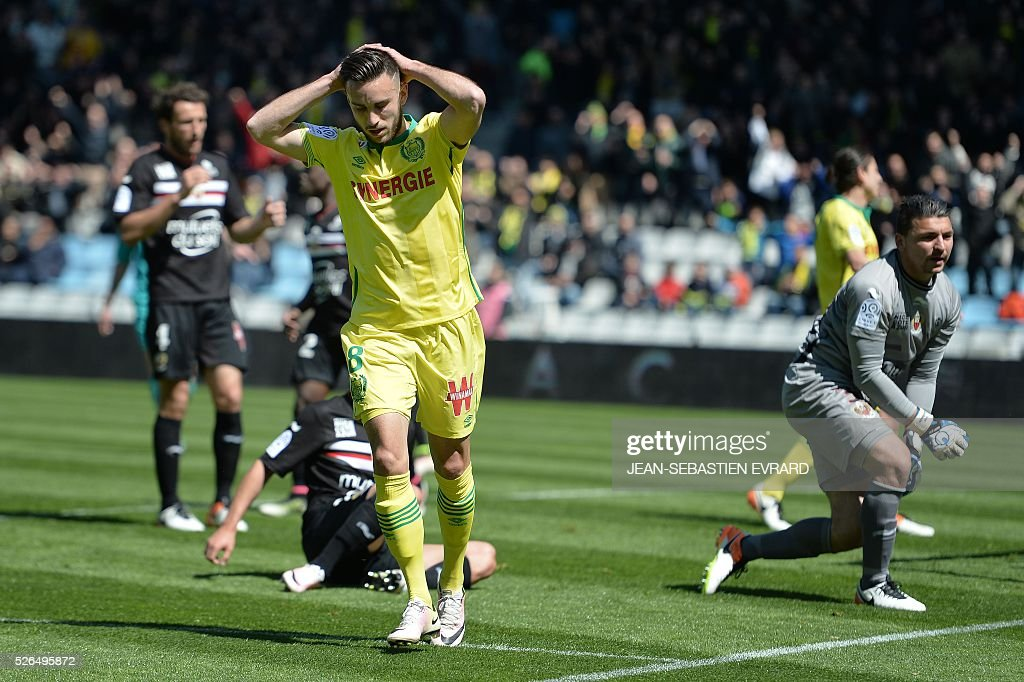 Nantes' French midfielder Adrien Thomasson reacts after missing a goal opportunity during the French L1 football match between Nantes and Nice on April 30, 2016 at the Beaujoire stadium in Nantes, western France.
