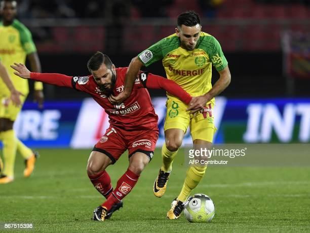 Nantes' French midfielder Adrien Thomasson vies with Dijon's French midfielder Frederic Sammaritano during the French L1 football match between Dijon...