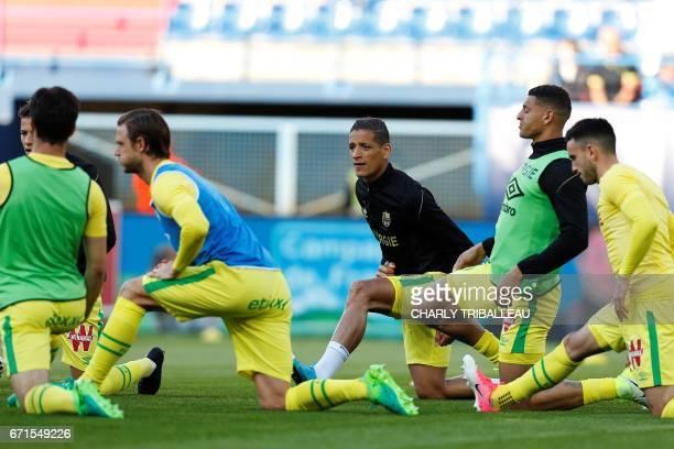 Nantes' French midfielder Amine Harit and teammates warm up before the French L1 football match between Caen and Nantes on April 22 2017 at the...