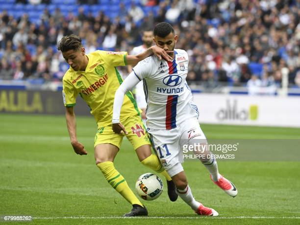 Nantes' French midfielder Amine Harit challenges Lyon's FrenchAlgerian midfielder Rachid Ghezzal during the French L1 football match between Lyon and...