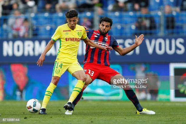 Nantes' French midfielder Amine Harit vies for the ball with Caen's French defender Syam Ben Youssef during the French L1 football match between Caen...