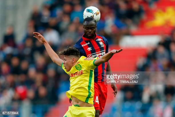 Nantes' French midfielder Amine Harit vies for the ball with Caen's Ivorian midfielder Tiemoko Ismael Diomande during the French L1 football match...