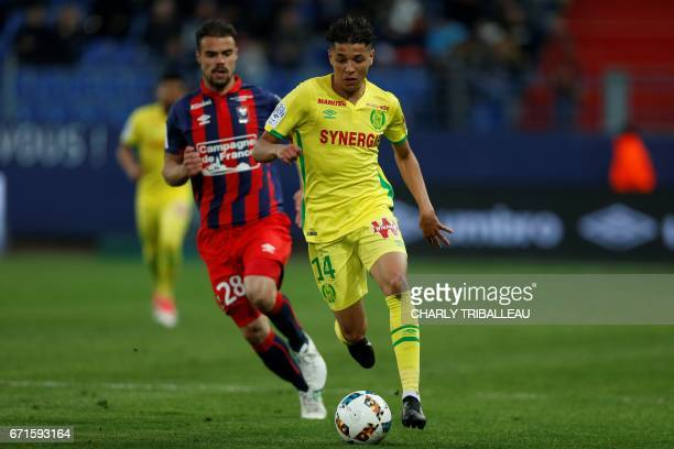 Nantes' French midfielder Amine Harit vies with Caen's French defender Damien Da Silva during the French L1 football match between Caen and Nantes on...