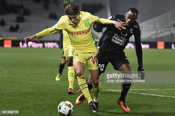 Nantes' French midfielder Amine Harit vies with Caen's French forward Herve Bazile during the French L1 football match between Nantes and Caen on...