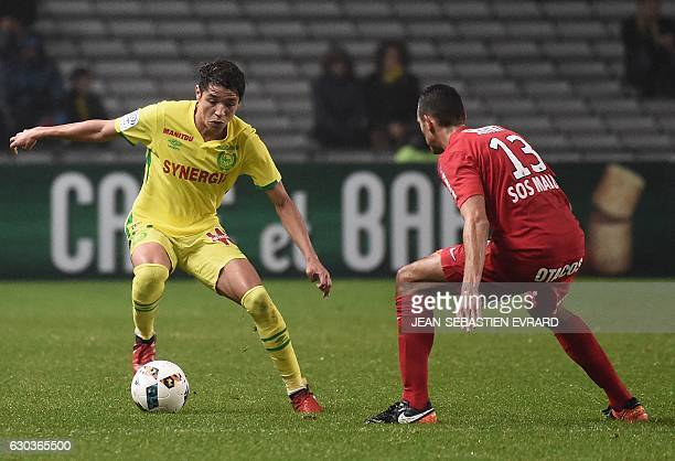 Nantes' French midfielder Amine Harit vies with Montpellier's French midfielder Ellyes Skhiri during the French L1 football match between Nantes and...