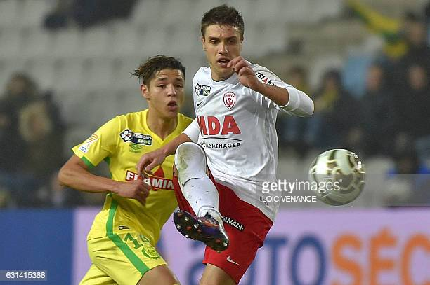 Nantes' French midfielder Amine Harit vies with Nancy's French defender Joffrey Cuffaut during the French league cup quarter final match Nantes vs...