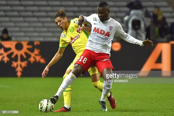 Nantes' French midfielder Amine Harit vies with Nancy's Mauritanian midfielder Dialo Guidileye during the French league cup quarter final match...