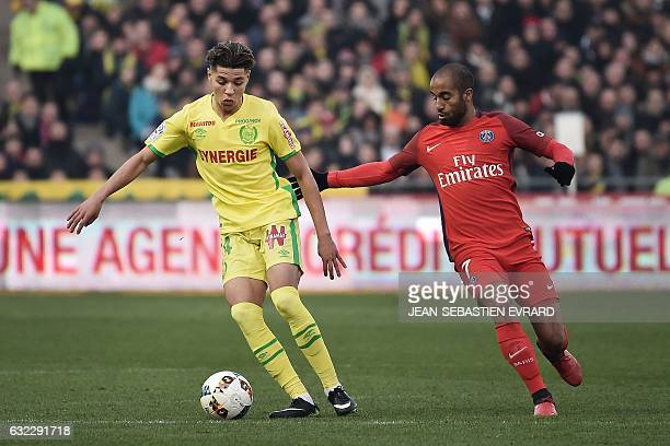 Nantes' French midfielder Amine Harit vies with Paris SaintGermain's Brazilian midfielder Lucas Moura during the French L1 football match between...