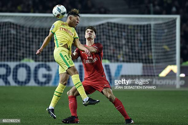 Nantes' French midfielder Amine Harit vies with Paris SaintGermain's Belgian defender Thomas Meunier during the French L1 football match between...