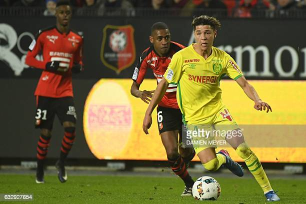 Nantes' French midfielder Amine Harit vies with Rennes' Cape Verdean midfielder Gelson Fernandes during the French L1 football match between Rennes...