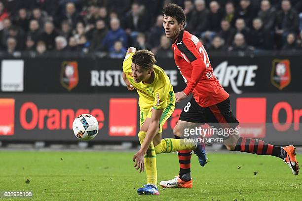 Nantes' French midfielder Amine Harit vies with Rennes' French midfielder Yoann Gourcuff during the French L1 football match between Rennes and...