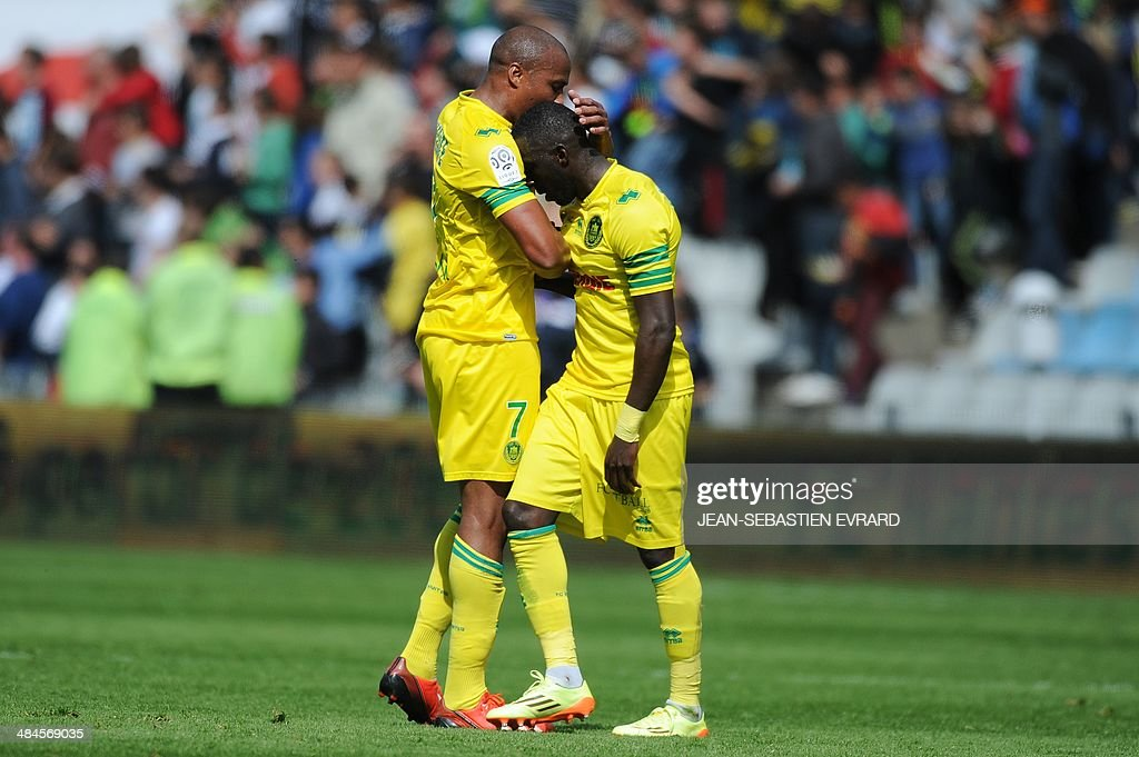 Nantes' French midfielder Fabrice Pancrate (L) and Nantes' French defender Issa Cissokho celebrate after winning the French L1 football match between Nantes and Guingamp on April 13, 2014 at the Beaujoire stadium in Nantes, western France.