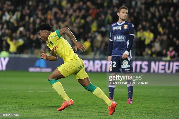 Nantes' French midfielder Georges Kevin Nkoudou celebrates after scoring a goal during the French L1 football match between Nantes and...