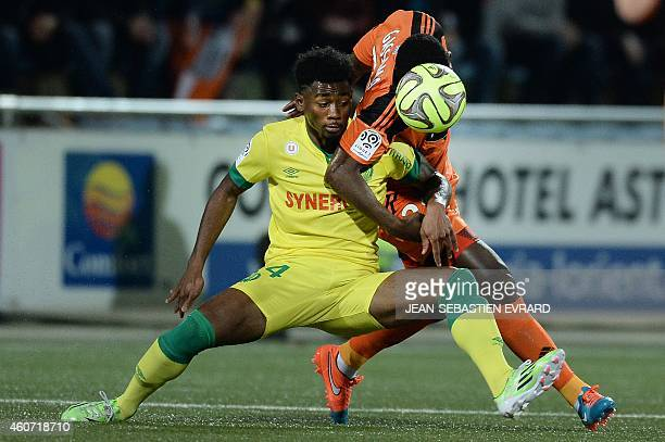 Nantes' French midfielder Georges Kevin Nkoudou vies with Lorient's French Senegalese defender Lamine Gassama during the French L1 football match...
