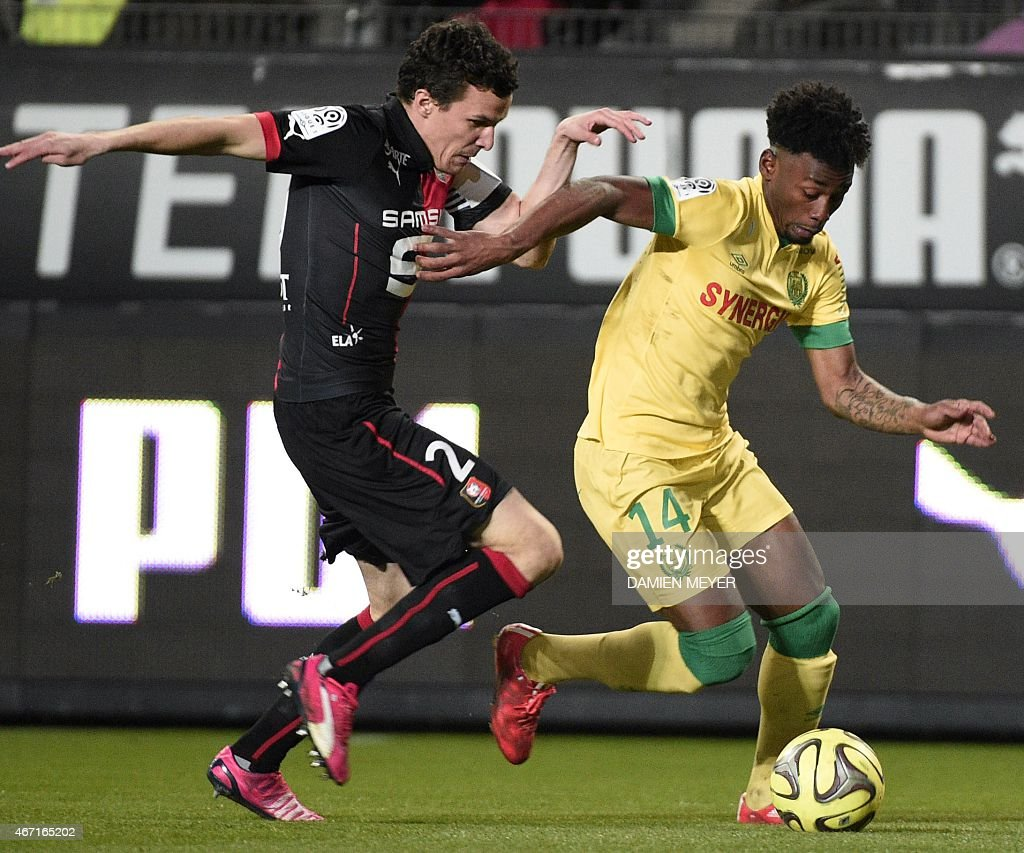 Nantes' French midfielder Georges Kevin Nkoudou (C) vies with Rennes' French defender <a gi-track='captionPersonalityLinkClicked' href=/galleries/search?phrase=Romain+Danze&family=editorial&specificpeople=4121826 ng-click='$event.stopPropagation()'>Romain Danze</a> (L) during the French L1 football match Rennes against Nantes on March 21, 2015 at the route de Lorient stadium in Rennes, western France.