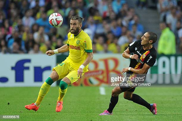 Nantes' French midfielder Lucas Deaux vies with Lens' French midfielder Alharbi El Jadeyaoui during the French L1 football match Montpellier vs...