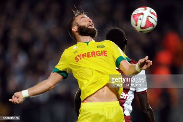 Nantes' French midfielder Lucas Deaux vies with Sochaux' French and Malian defender Cedric Kante during the French L1 football match between FC Metz...
