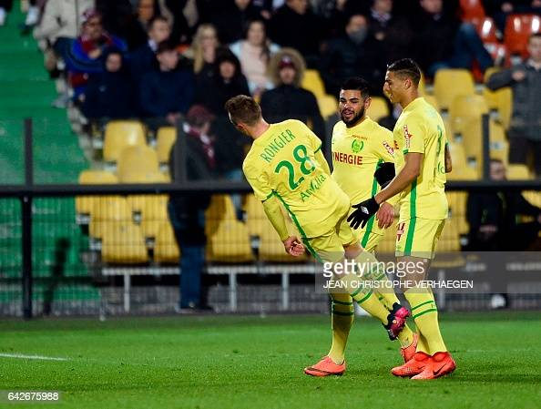 TOPSHOT Nantes' French midfielder Valentin Rongier celebrates with his teammates after scoring a goal during the French L1 football match between...