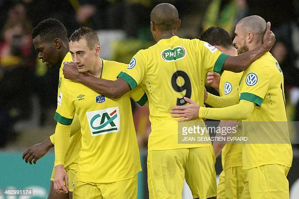 Nantes' French midfielder Valentin Rongier celebrates with teammates after scoring a goal during the French Cup round of 64 football match between...