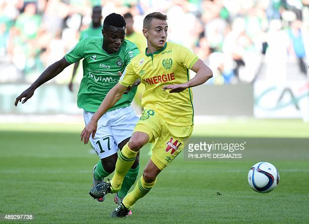 Nantes' French midfielder Valentin Rongier vies with SaintEtienne's French forward Jonathan Bamba during the French Ligue 1 football match between AS...