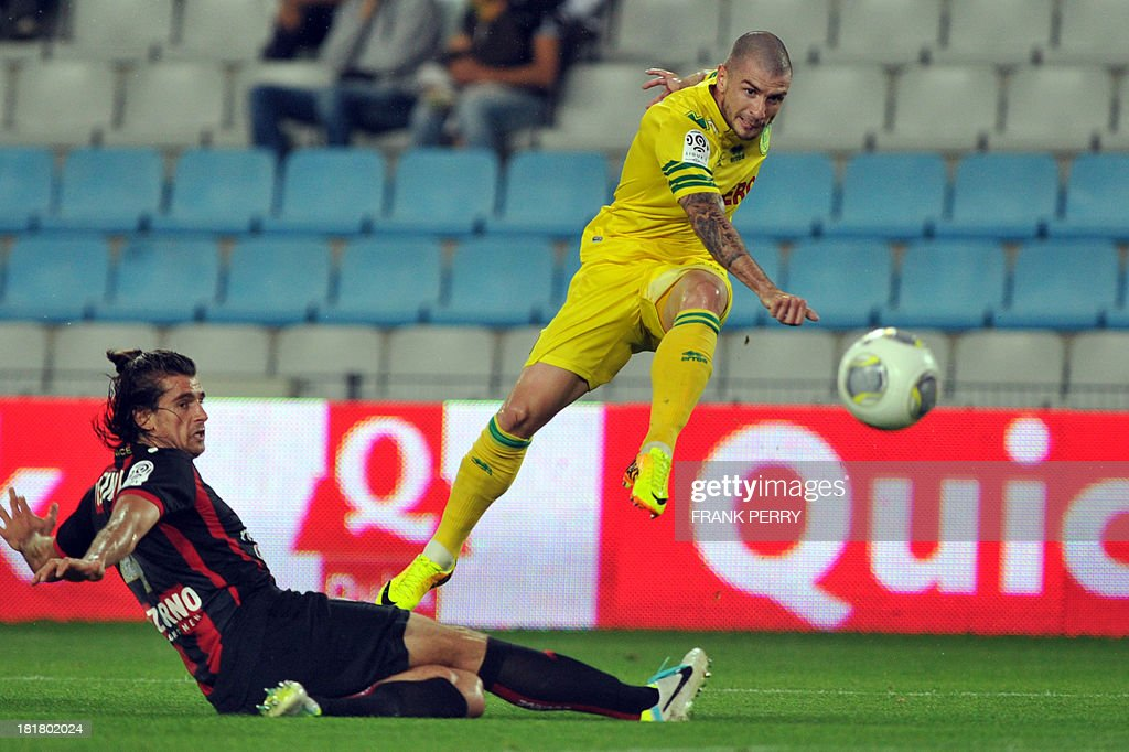 Nantes' French midfielder Vincent Bessat (R) kicks the ball despite Nice's Serbian defender Nemanja Pejcinovic (L) during a French L1 football match Nantes against Nice on September 25, 2013 in La Beaujoire stadium in Nantes, western France.