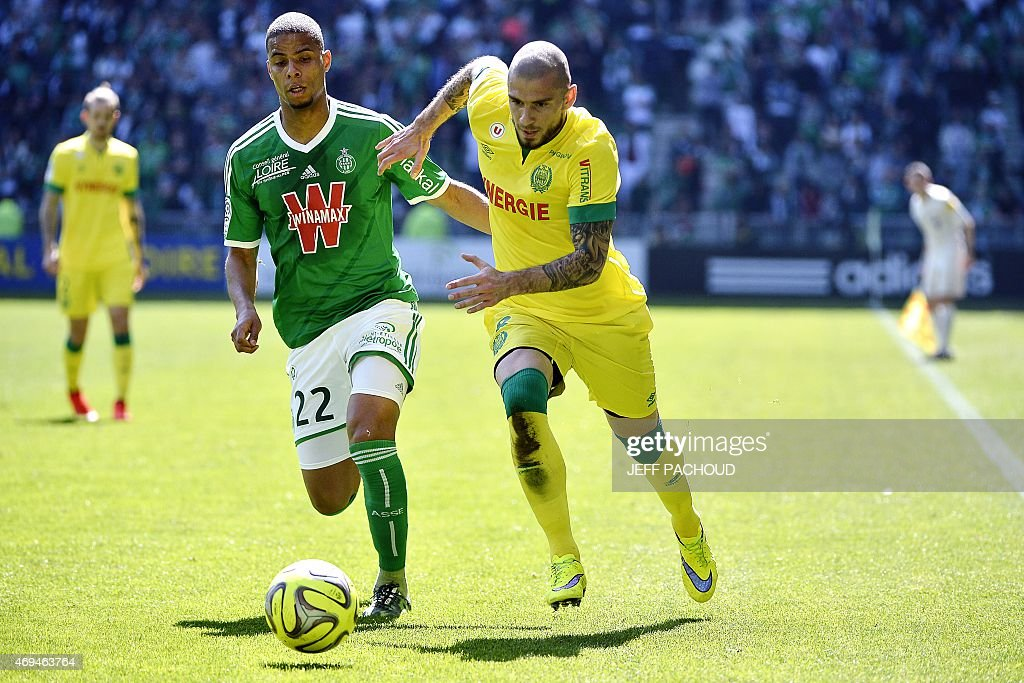 Nantes' French midfielder Vincent Bessat (R) vies with St Etienne's French forward <a gi-track='captionPersonalityLinkClicked' href=/galleries/search?phrase=Kevin+Monnet-Paquet&family=editorial&specificpeople=4044138 ng-click='$event.stopPropagation()'>Kevin Monnet-Paquet</a> (L) during the French L1 football match AS Saint-Etienne (ASSE) vs FC Nantes (FCN) on April 12, 2015, at the Geoffroy Guichard Stadium in Saint-Etienne, central France.