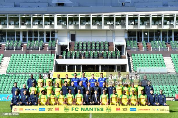 Nantes' French Polish president Waldemar Kita poses with Nantes' Italian head coach Claudio Ranieri players and staff members during the official...