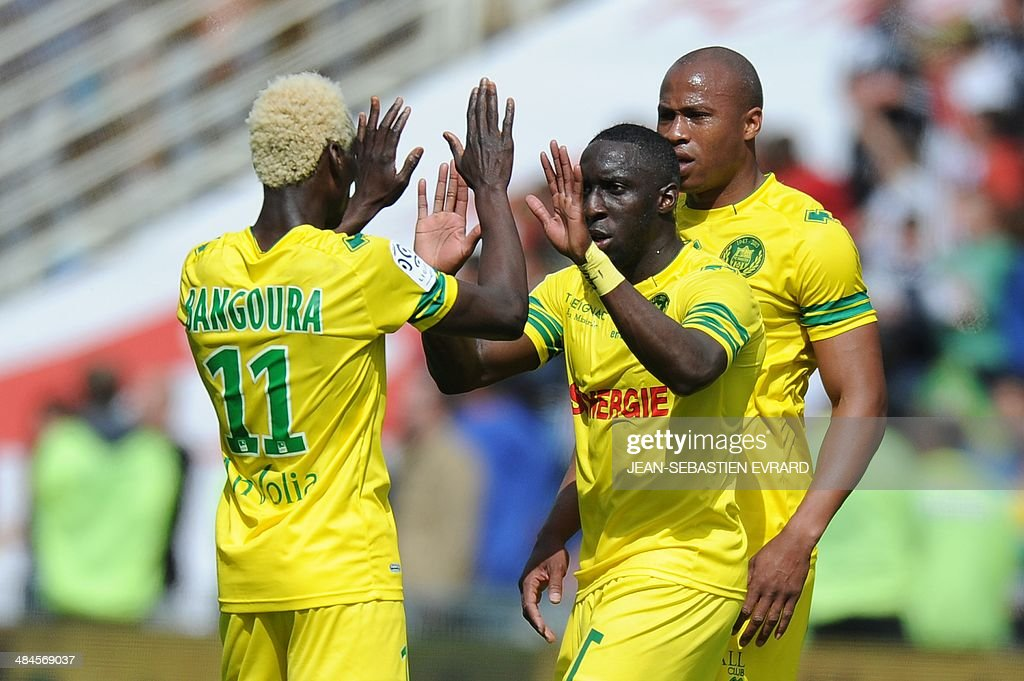 Nantes' Guinean forward Ismael Bangoura, Nantes' French defender Issa Cissokho and Nantes' French midfielder Fabrice Pancrate celebrate after winning the French L1 football match between Nantes and Guingamp on April 13, 2014 at the Beaujoire stadium in Nantes, western France.