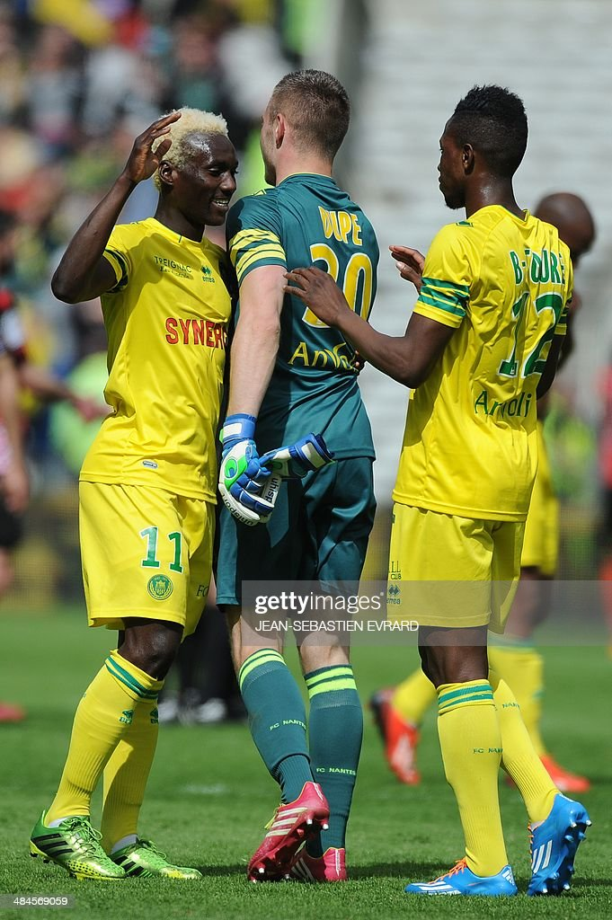 Nantes' Guinean forward Ismael Bangoura, Nantes' French goalkeeper Maxime Dupe and Nantes' Malian midfielder Birama Toure celebrate after winning the French L1 football match between Nantes and Guingamp on April 13, 2014 at the Beaujoire stadium in Nantes, western France.