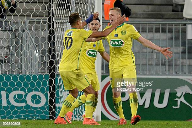 Nantes' Icelandic forward Kolbeinn Sigthorsson celebrates with teammates after scoring a goal during the French Cup round of 16 football match...