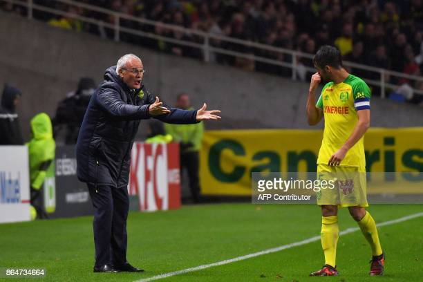 Nantes' Italian head coach Claudio Ranieri gestures to Nantes' French defender and captain Leo Dubois during the French L1 football match between...