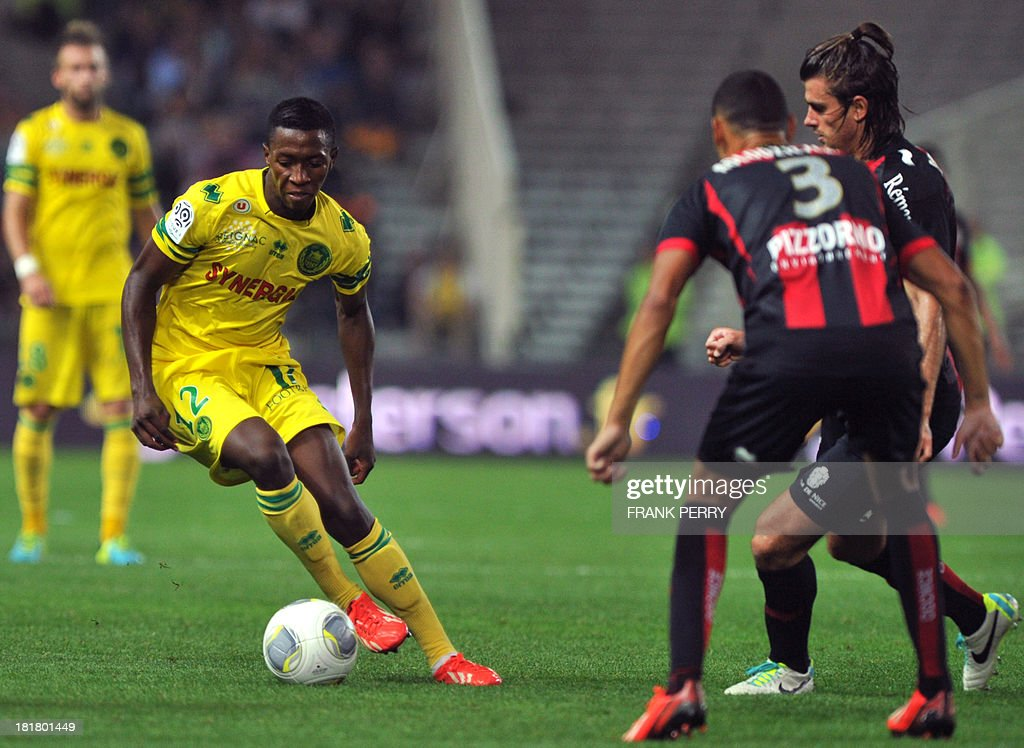 Nantes' Malian midfielder Birama Toure (L) vies with Nice's French defender Thimothee Kolodziejczak (2ndR) and Nice's Serbian defender Nemanja Pejcinovic (R) during a French L1 football match Nantes against Nice on September 25, 2013 in La Beaujoire stadium in Nantes, western France.