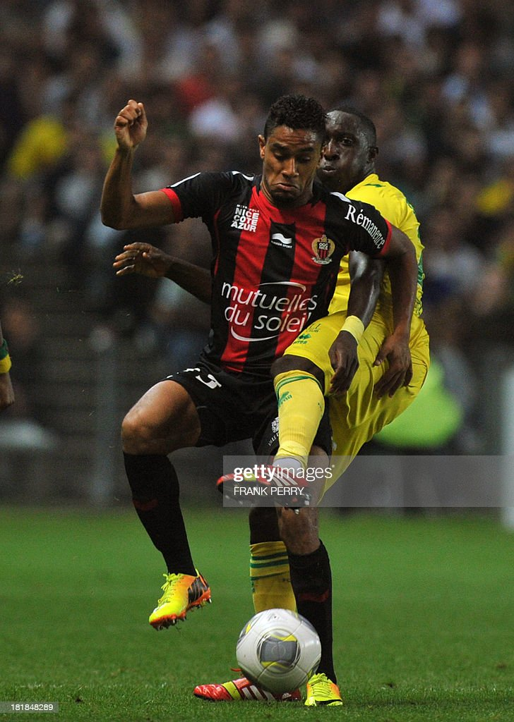 Nantes' Malian midfielder Birama Toure (R) vies with Nice's French defender Jordan Amavi the French L1 football match Nantes vs Nice on September 25, 2013 at La Beaujoire stadium in Nantes, western France.