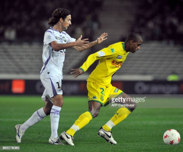 Nantes' midfielder Ricardo Faty vies with Toulouse's defender Gilles Siriex during the French League 1 Football match Nantes versus Toulouse on...