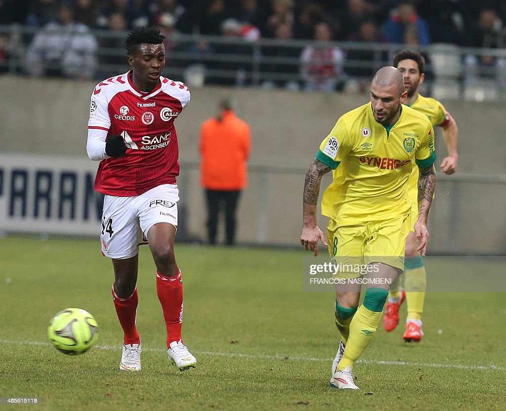 Nantes midfielder Vincent Bessat (R) fights for the ball with Reims forward <a gi-track='captionPersonalityLinkClicked' href=/galleries/search?phrase=Benjamin+Moukandjo&family=editorial&specificpeople=7470600 ng-click='$event.stopPropagation()'>Benjamin Moukandjo</a> (L) on March 7, 2015 during a French L1 football match Reims vs. Nantes at the Auguste Delaune Stadium in Reims. PHOTO