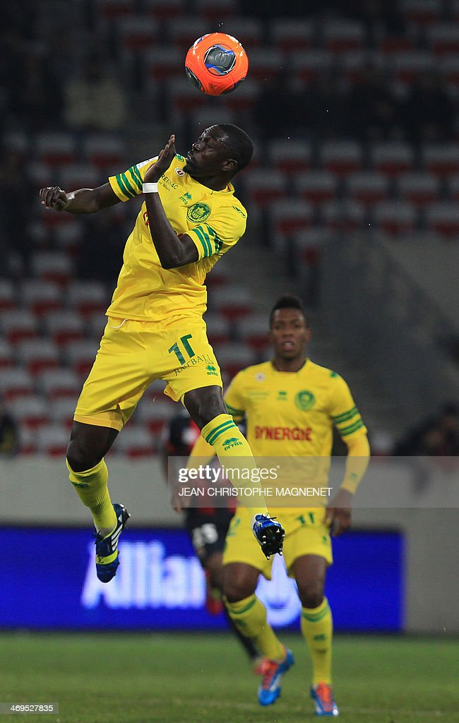 Nantes' mildfielder Remi Gomis heads the ball during the French L1 football match between OGC Nice (OGCN) and FC Nantes (FCN) on February 15, 2014, at the Allianz Riviera stadium, in Nice, southeastern France. AFP PHOTO / JEAN CHRISTOPHE MAGNENET