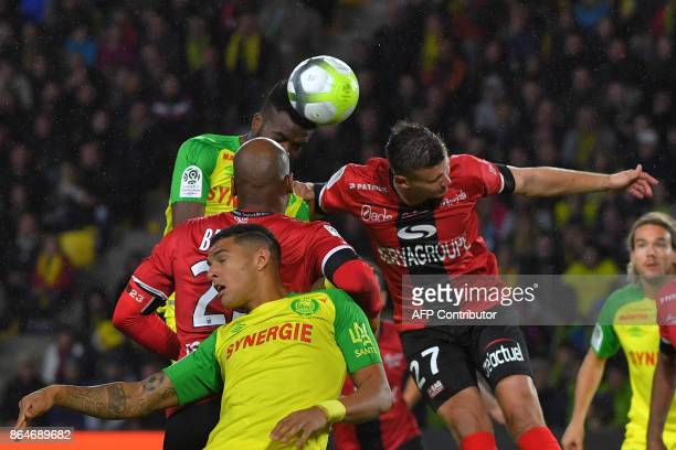 Nantes' Nigerian defender Chidozie Awaziem heads to score during the French L1 football match Nantes vs Guingamp at the La Beaujoire stadium in...