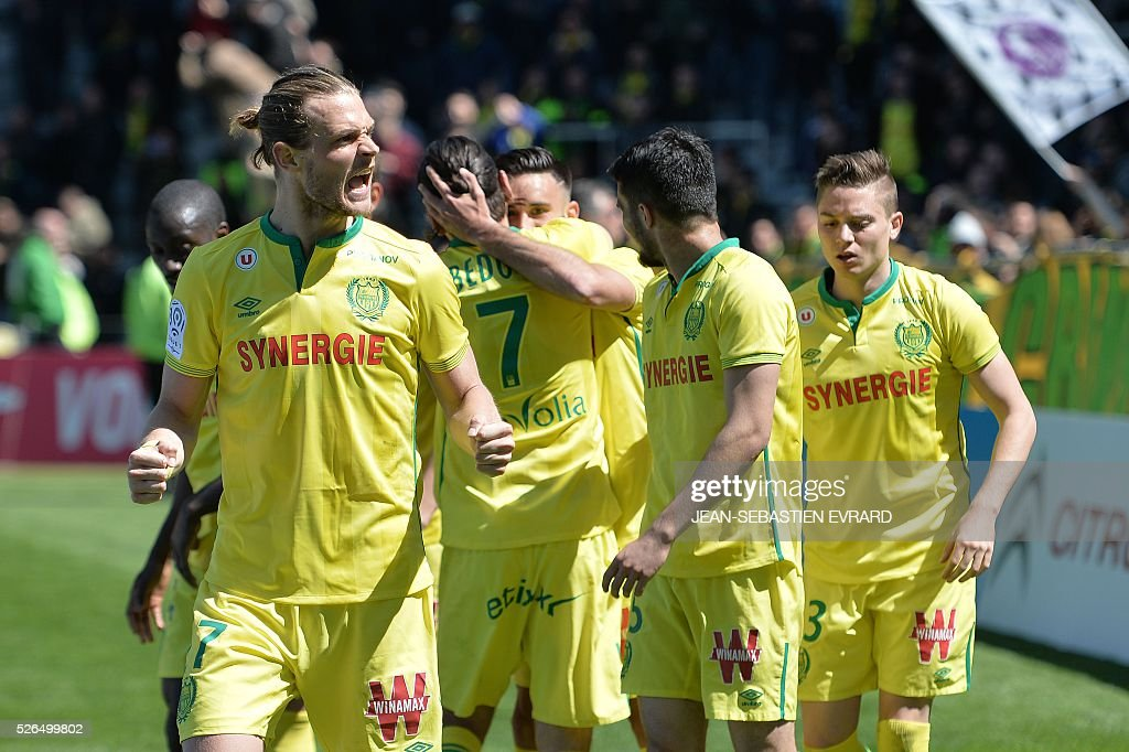 Nantes players celebrate after scoring the opening goal during the French L1 football match between Nantes and Nice on April 30, 2016 at the Beaujoire stadium in Nantes, western France.