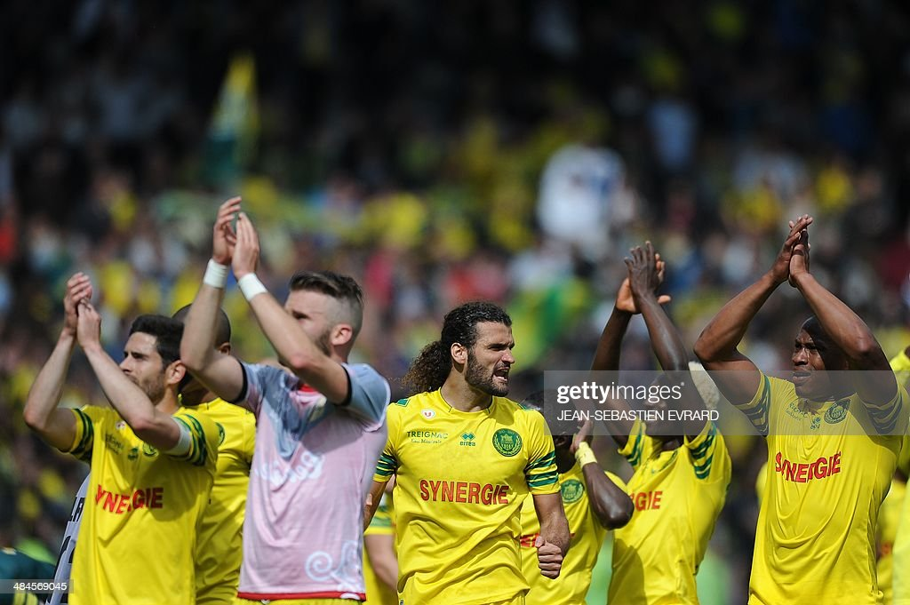 Nantes' players celebrate after winning the French L1 football match against Guingamp on April 13, 2014 at the Beaujoire stadium in Nantes, western France.
