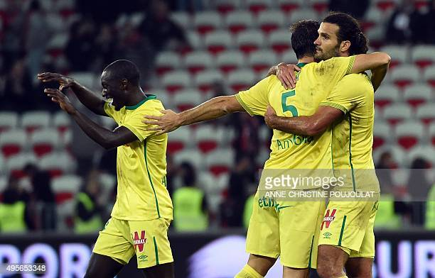 Nantes players celebrate at the end of the French L1 football match between Nice and Nantes at the Allianz Riviera Stadium in Nice southern France on...
