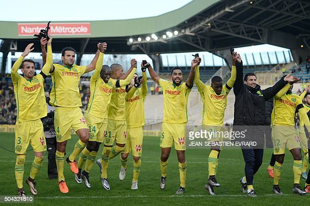 Nantes' players celebrate at the end of the French L1 football match between Nantes and SaintEtienne on January 10 2015 at the Beaujoire stadium in...