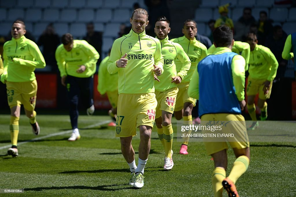 Nantes' players warm up prior to the French L1 football match between Nantes and Nice on April 30, 2016 at the Beaujoire stadium in Nantes, western France.