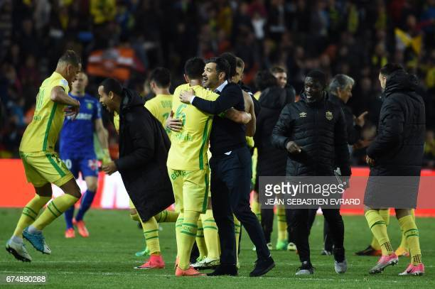 Nantes' Portuguese head coach Sergio Conceicao celebrates with his players at the end of the French L1 football match Nantes vs Lorient on April 29...