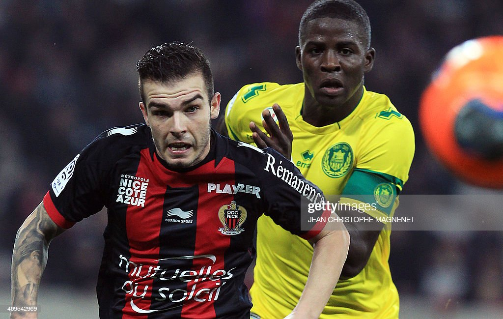 Nantes' Senegalese defender Papy Mison Djilibodji (R) and Nice's French forward Alexy Bosetti (L) during the French L1 football match between Nice (OGCN) and Nantes (FCN) on February 15, 2014 at the Allianz Riviera stadium, in Nice, southeastern France.