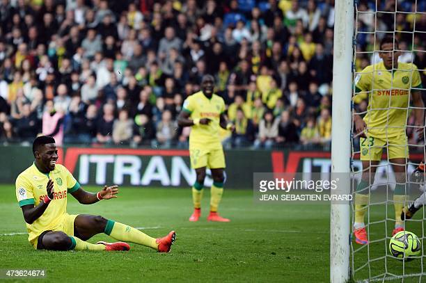 Nantes' Senegalese defender Papy Mison Djilibodji reacts as he scores a goal against his own team during the French L1 football match between Nantes...
