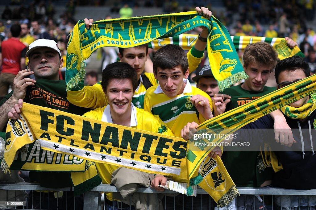 Nantes' supporters cheer before the French L1 football match between Nantes and Guingamp on April 13, 2014 at the Beaujoire stadium in Nantes, western France.